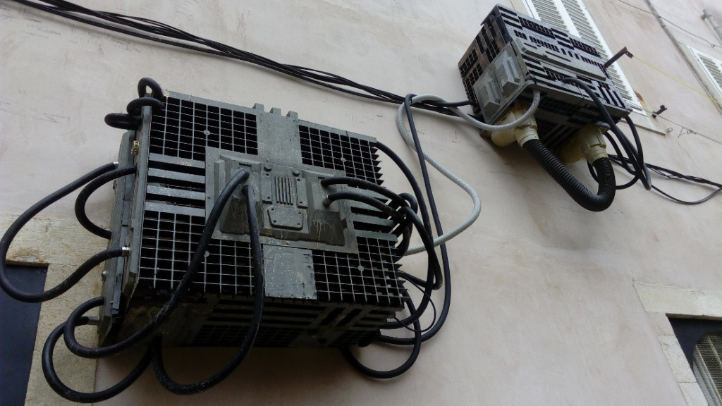 Air Conditioning units masked to fit into the look of the set, photo spacepetuniareview.com